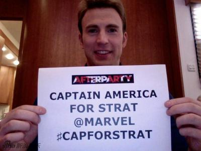 Captain America,aka Chris Evans with a piece of paper