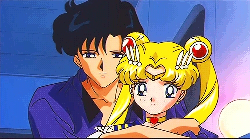 Sailor moon? I dont know if it counts but Bunny and Mamoru do have a romance there.