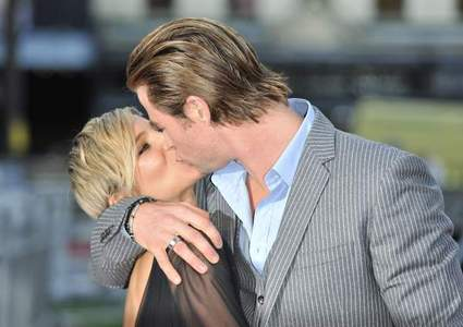 Chris and his wife,Elsa sharing a kiss on the red carpet at one of his premieres