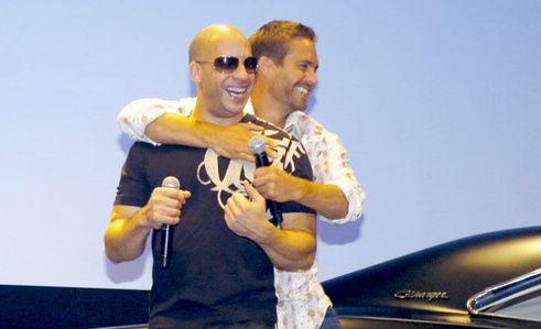 a Fast and Furious bro hug between Paul Walker and Vin Diesel