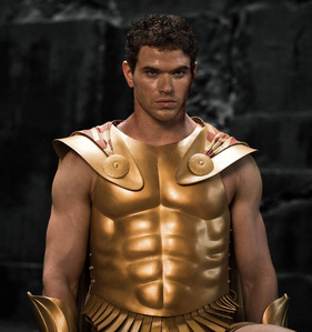 Kellan wearing a gold plated chest protector(from Immortals)