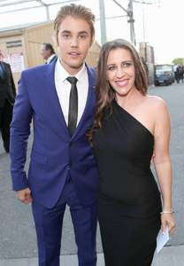 Justin and his proud mama,Pattie