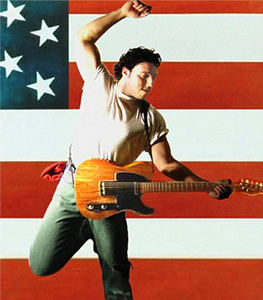 Bruce Springsteen with the American flag behind him