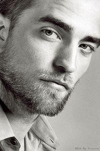 Robert looking at us with his hypnotic eyes<3