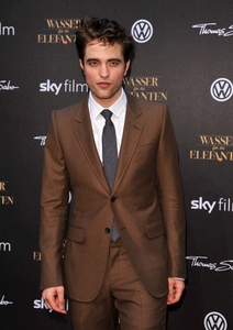 I do not like the color of this suit on my babe,because it's the color of poo and it's definitely not his color