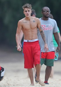 Bieber in red shorts