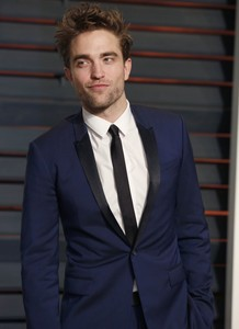 that blue suit matches his blue eyes<3