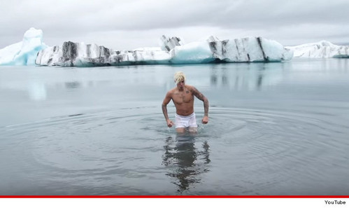 hot guy in the frigid cold waters of Iceland