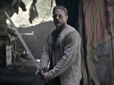 couldn't find a pic of Robert with a sword,but here's a pic of Charlie Hunnam with a sword