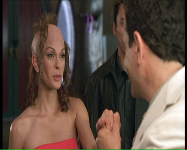 "Teri Hatcher loses her hair in ""Spy Kids"". I always thought that if Teri actually had to lose her hair for the part of Ms. Gradenko, would feel sorry for her."