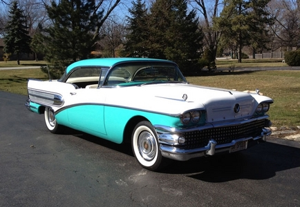 The 1950's. I could buy myself a brand new car for the price of a used one. I'd like to cruise through town in this Buick.