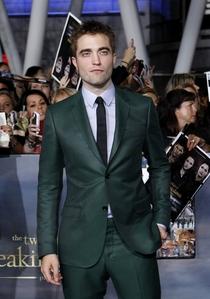 he looks sooo fine in that suit<3