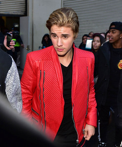 Biebz in a cool red leather জ্যাকেট