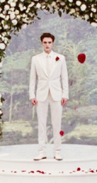 my babe in his wedding attire...he looks like he belongs on вверх of a wedding cake<3