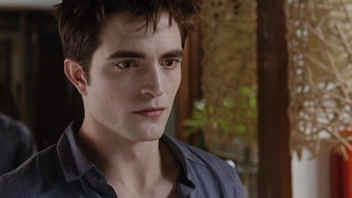 Robert (as Edward) looking worried and a little scared for his wife Bella in a scene from Breaking Dawn part 1