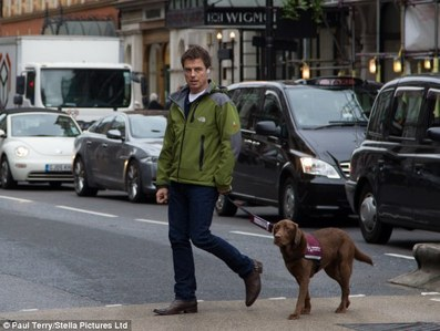 John taking a dog for a walk :)