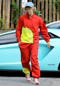 Biebz in a red and yellow tracksuit