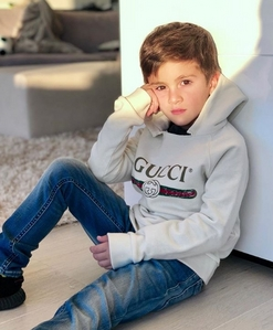 I upendo Leo Messi. He's the best player in the history of football. He's amazingly good-looking. He's got nice abs. His wife is the hottest lady in this world. And his children are so cute, especially the oldest one, he's already posing like a model