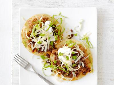Tostadas, tried finding a picture but mine had fresh cheese, chopped bawang, bawang merah and selada on it, beans and beef.