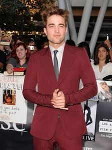 Rob looking red hot in that red suit.I just want to rip it off him