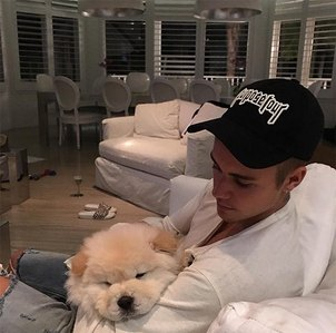 Justin holding a cute,cuddly puppy