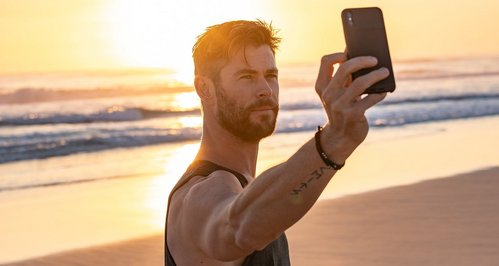 taking a selfie on his phone<3