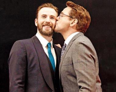 Captain America,aka Chris Evans getting a Kiss from Iron Man,aka Robert Downey Jr