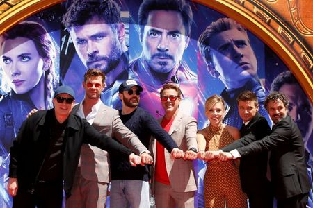 repost because I really like this pic...Chris and his fellow Avengers with their director clenching their fists together from their handprint ceremony!!!!!!!!