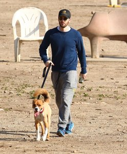 just an all America(n) guy out for a walk ...with his dog