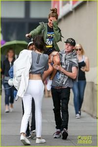 Hailey Bieber on Jaden Smith shoulders .