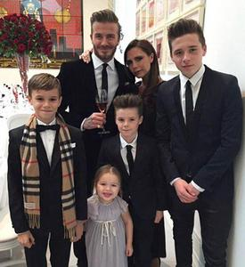 Victoria beckham with David and her kids !