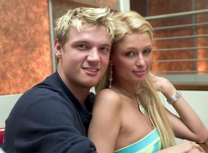 Nick with Paris Hilton who was such a bad influence !! Can't sfand her and never will 💀