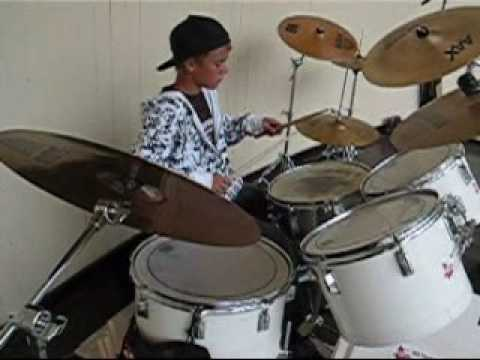 young Justin on the drums