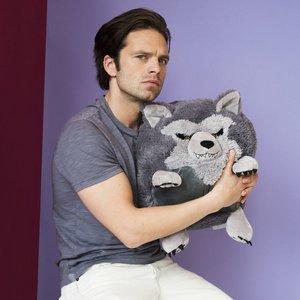 Sebastian holding a dog unan