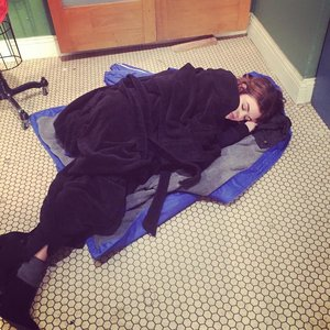 Lucy Hale, sleeping on a hard floor. I don't know how anyone could sleep on a hard floor. It would be so painful.