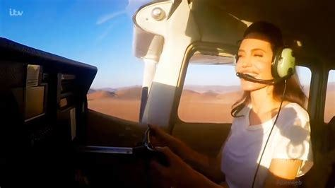 Angelina who is an avid pilot flying a helicopter over Namibia