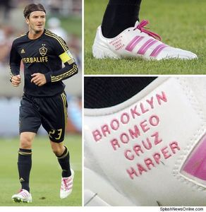 Bend it like Beckham wearing football (soccer) shoes with his kids names on them