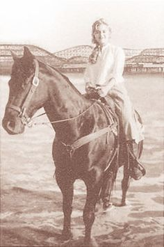 Kate on a horse from the end of Titanic