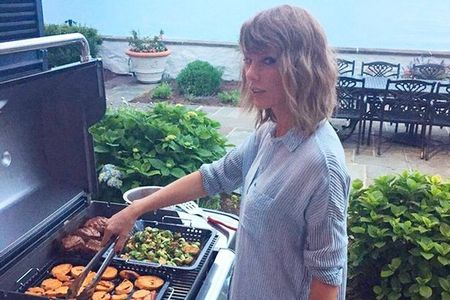 Taylor cooking on the barbeque.