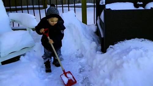 a young Justin with snow