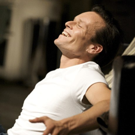 Post a picture of an actor lying back.
