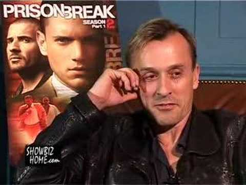 Post a pic of your actor with a poster behind him.