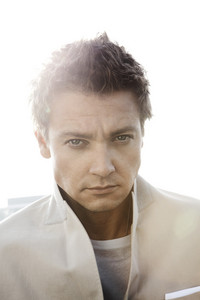 Post a picture of an actor in a white suit.