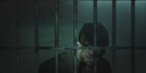 Post a picture of an actor behind bars.