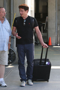 Post a picture of an actor with a suitcase.