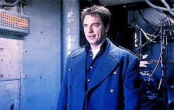 Post a picture of an actor in a blue coat.