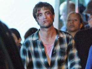 Post a pic of your actor looking all bloodied and beat up.Mine is of my sexy Robert Pattinson,filming Remember Me.My poor handsome Rob.He needs some TLC,which I will happily administer him 24/7.