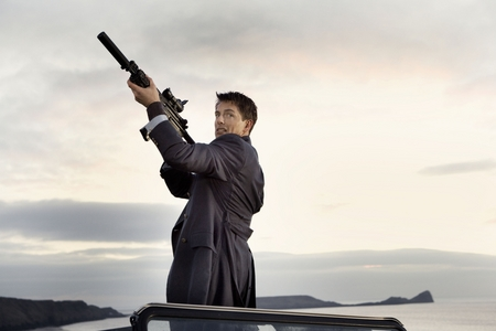 Post a picture of an actor pointing a gun.