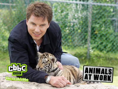 Post a picture of an actor with a animal.