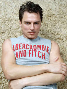 Post a picture of an actor with some words written on his t-shirt/vest.